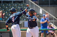 Northwest Arkansas Naturals catcher Xavier Fernandez (34) (right) celebrates with outfielder Anderson Miller (4) after hitting a home run on May 19, 2019, at Arvest Ballpark in Springdale, Arkansas. (Jason Ivester/Four Seam Images)