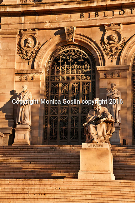 Statues on the steps of the National Library, founded by King Philip V in 1712, in Madrid