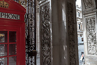UK. London. 29th March 2018<br /> One of the oldest phone booths in London, positioned at the entrance to the Royal Academy.<br /> Andrew Testa for the New York Times