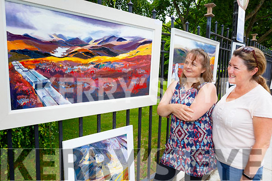 Mary Sheehan from Knocknacree showing her works to Annmarie O'Connor from Blennerville at the Art Exhibition in Denny Street on Saturday morning.