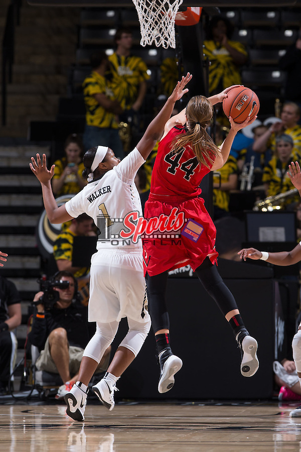 Destini Walker (1) of the Wake Forest Demon Deacons defends against Mackenzie Latt (44) of the Davidson Wildcats during second half action at the LJVM Coliseum on November 17, 2015 in Winston-Salem, North Carolina.  The Demon Deacons defeated the Wildcats 77-58.  (Brian Westerholt/Sports On Film)