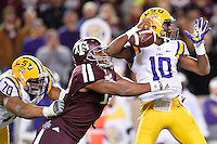 Texas A&M defensive lineman Myles Garrett (15) tackles LSU quarterback Anthony Jennings (10) causing a fumble during an NCAA football game, Thursday, November 27, 2014 in College Station, Tex. (Mo Khursheed/TFV Media via AP Images)