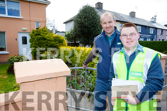 Stephen Roche delivers the post on his rounds as a Postman for a day with Sean Morris in  Killarney on Wednesday