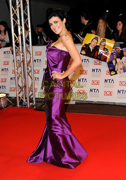 KYM MARSH .At the National Television Awards, held at O2 Arena, London, England, UK, January 20th 2010..arrivals TV NTA full length purple strapless dress hand on hip side long maxi origami folded front .CAP/FIN.©Steve Finn/Capital Pictures.