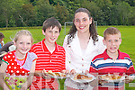 Seadhbh Clifford, Risteard Clifford, Aisling Clifford and Mark Cahill filling up at the Killarney Athletic Barbecue in Woodlawn last Sunday..