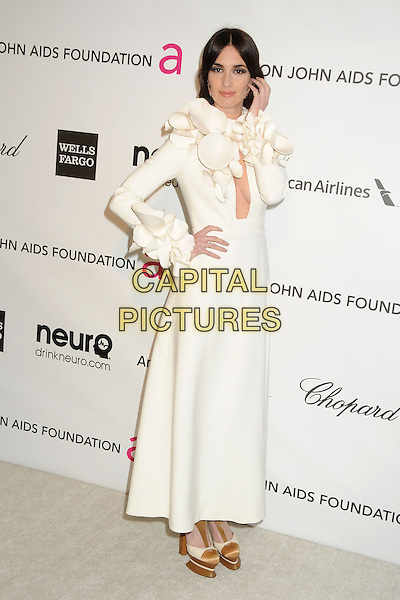 Paz Vega.21st Annual Elton John Academy Awards Viewing Party held at West Hollywood Park, West Hollywood, California, USA..February 24th, 2013.oscars full length dress long sleeves gold platform shoes white corsage  cut out cleavage hand arm on hip.CAP/ADM/BP.©Byron Purvis/AdMedia/Capital Pictures.