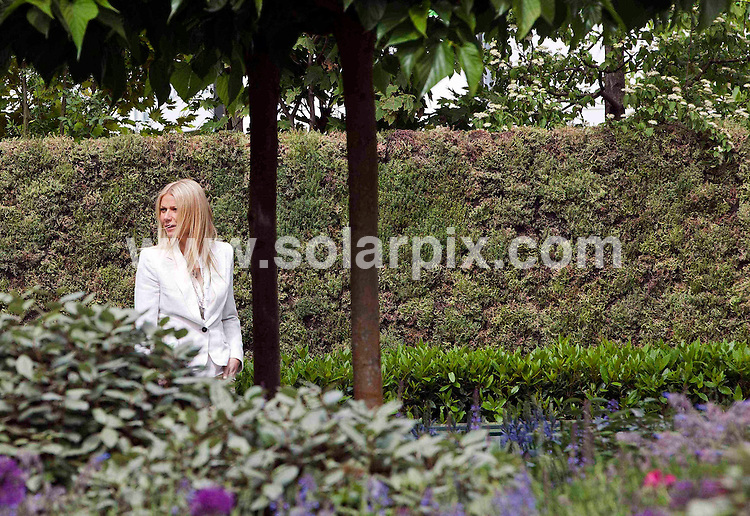 **ALL ROUND PICTURES FROM SOLARPIX.COM**                                             **NO UK NEWSPAPER PUBLICATION**.**UK MAGAZINE & SUPPLEMENT PUBLICATION ONLY** AND NO PUBLICATION IN AUSTRALIA, BELGIUM, FRANCE, GERMANY, ITALY, SCANDINAVIA AND USA**                                                                                  Caption: Hollywood actress Gwyneth Paltrow pictured with her book - Notes From My Kitchen Table - in the B&Q garden at Chelsea Flower Show in London. The B&Q garden focuses on growing your own food. Chelsea Flower Show, London, UK. 23 May 2011                                                                              This pic: Gwyneth Paltrow                                                                                             JOB REF: 13411 SFE       DATE: 23_05_2011                                                           **MUST CREDIT SOLARPIX.COM OR DOUBLE FEE WILL BE CHARGED**                                                                      **MUST AGREE FEE BEFORE ONLINE USAGE**                               **CALL US ON: +34 952 811 768 or LOW RATE FROM UK 0844 617 7637**
