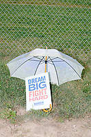 """An umbrella stands over a campaign for Democratic presidential candidate and Massachusetts senator Elizabeth Warren reading """"Dream Big Fight Hard"""" before the Labor Day Parade in Milford, New Hampshire, on Mon., September 2, 2019. Candidates Bernie Sanders and Vermin Supreme were the only candidates who marched in the parade this year."""