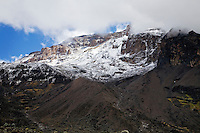 Kibo, the highest peak on Kilimanjaro, seen through the clouds from Barranco Camp
