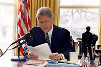 ***FILE PHOTO*** Bill Clinton Has Not Apologized To Monica Lewinsky And Claims Did The Right Thing Staying In Office.<br /> <br /> United States President Bill Clinton delivers his radio address on the budget live from the Oval Office of the White House in Washington, DC on January 6, 1996<br /> CAP/MPI/RS<br /> &copy;RS/MPI/Capital Pictures