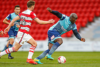 Adebayo Akinfenwa of Wycombe Wanderers (right) during the Sky Bet League 2 match between Doncaster Rovers and Wycombe Wanderers at the Keepmoat Stadium, Doncaster, England on 29 October 2016. Photo by David Horn.