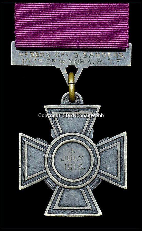 BNPS.co.uk (01202 558833)<br /> Pic: DixNoonanWebb/BNPS<br /> <br /> The reverse of the Victoria Cross showing that Sanders won it on 1 July 1916, the first day of the Battle of the Somme.<br /> <br /> A Victoria Cross awarded to a hero British soldier on the first day of the Somme is being sold by his family for £220,000 over 100 years later.<br /> <br /> Corporal George Sanders led a band of 30 men in repelling repeated German attacks over two days after a communications break down left them cut off in an enemy trench.<br /> <br /> For nearly two days without any food or water, he drove off a raid by the enemy which required hand-to-hand combat using bayonets and then stood firm against two strong bombing attacks.<br /> <br /> His Victoria Cross and Military Cross have been passed down through the family and are now to be sold for the very first time at London auctioneers Dix Noonan Webb.