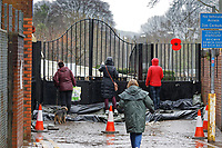 Pictured: Locals gather by the closed gates to a footbridge leading over the river Taff in Pontypridd, Wales, UK. Sunday 16 February 2020<br /> Re: Storm Dennis has been affecting parts of Wales, UK.