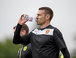 Stephen McManus takes on some fluid at training