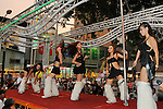 Bao-Jhong Yi-min Temple, Kaohsiung -- Pole dancers performing on the back of a truck at the annual 'Divine Pig' (Shen Zhu) festival during Ghost Month.