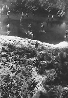 Marines hit three feet of rough water as they leave their LST to take the beach at Cape Gloucester, New Britain.  December 26, 1943.  Sgt. Robert M. Howard.  (Marine Corps)<br /> NARA FILE #:  127-N-68998<br /> WAR &amp; CONFLICT BOOK #:  1169