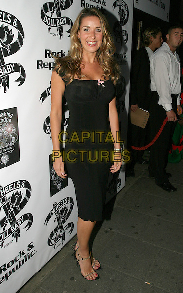 "CLARE SWEENEY.Attends ""Christmas in July "" Fashion Show and Party, Pangaea, London,.13th July 2004..full length little black dress with pink bow claire .Ref: AH.www.capitalpictures.com.sales@capitalpictures.com.©Capital Pictures."