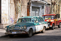 An old car rusty and flaky colour parked in the street, Green and white Desoto station wagon car from the 1950s 1950 50 50s or 1960s 1960 60s 60 Montevideo, Uruguay, South America