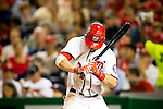 Washington Nationals outfielder Bryce Harper (34) bites his sleeves as he warms up in the batters box during a game against the Miami Marlins at Nationals Park in Washington, DC on September 7, 2012.