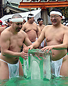 January 8, 2017, Tokyo, Japan - As if to say its not cold enough, blocks of solid ice are added to already freezing cold water during a new years annual rite in downtown Tokyo on a cold Sunday of January 8, 2017. Practitioners of Shinto, a Japanese ethnic religion focusing on ritual practices to be carried out diligently, immerse themselves in icy water under the frigid temperatures in the purification ritual, believed to cleanse the spirit or just to show off their bravery and endurance. (Photo by Natsuki Sakai/AFLO) AYF -mis-