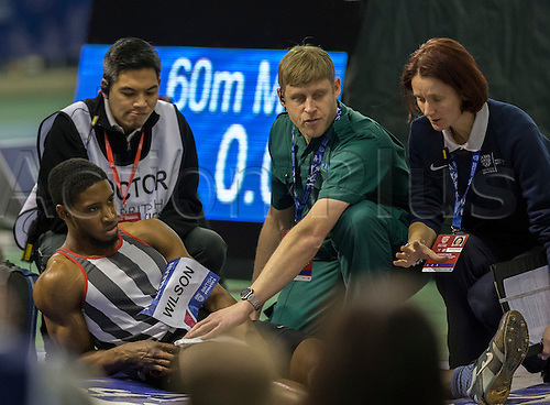 27.02.2016. EIS Sheffield, Sheffield, England. British Indoor Athletics Championships Day One. Darnte Wilson receives medical attention after he injuries himself in the Men's Triple Jump Final.