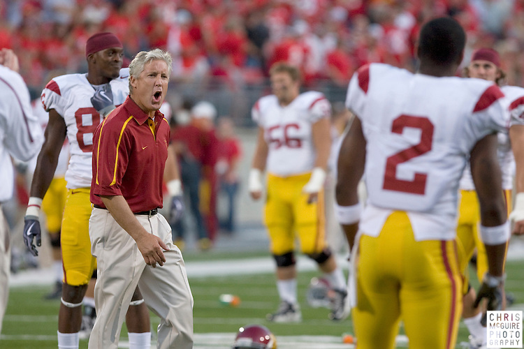 12 September 2009:  Football -- USC head coach Pete Carroll gets his players ready for their game against Ohio State at Ohio Stadium in Columbus.  USC won 18-15.  Photo by Christopher McGuire.