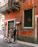 ITALY, Verona, men standing on street outside building