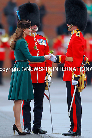 "KATE'S PRESENTS SHAMROCKS TO IRISH GUARDS.The Duchess of Cambridge presented shamrocks to members of 1 Irish Guards at Mons Barracks in Aldershot to mark the occasion of St Patricks Day_17/03/2012.Mandatory Credit Photo: ©NEWSPIX INTERNATIONAL..**ALL FEES PAYABLE TO: ""NEWSPIX INTERNATIONAL""**..IMMEDIATE CONFIRMATION OF USAGE REQUIRED:.Newspix International, 31 Chinnery Hill, Bishop's Stortford, ENGLAND CM23 3PS.Tel:+441279 324672  ; Fax: +441279656877.Mobile:  07775681153.e-mail: info@newspixinternational.co.uk"