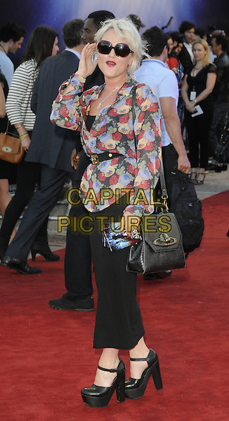 JAIME WINSTONE.UK Premiere of 'Cowboys and Aliens' at the Cineworld cinema at the O2 Arena, London, England..August 11th 2011.full length black leggings platform shoes mary janes red blue beige print floral top sunglasses shades hand mouth open side.CAP/CAN.©Can Nguyen/Capital Pictures.