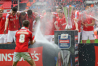 Conor Hourihane of Barnsley sprays his team mates with champagne after winning the Johnstone's Paint Trophy Final match between Oxford United and Barnsley at Wembley Stadium, London, England on 3 April 2016. Photo by Alan  Stanford / PRiME Media Images.