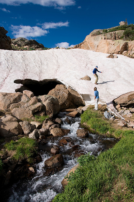couple, (MR), hike, alpine, snow cave, snow field, nature, stream, upper N. Fork Big Thompson River, high elevation, recreation, outdoors, activity, summer, August, morning, Rocky Mountain National Park, Colorado, USA