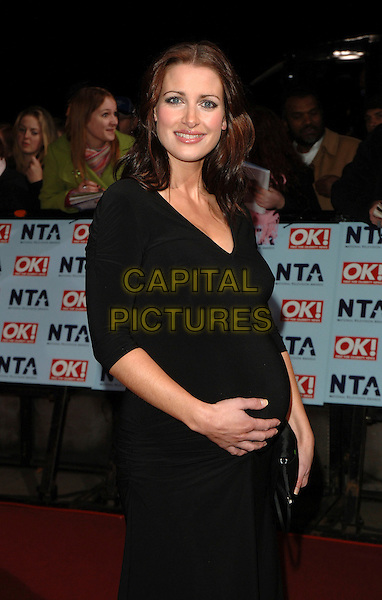 KIRTY GALLACHER.The National Television Awards 2006, Royal Albert Hall, London, UK. .October 31st, 2006.half length black dress pregnant .CAP/BEL.©Belcher/Capital Pictures