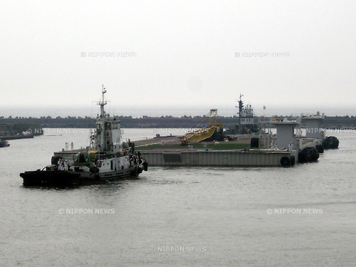 May 21st, 2011, Okumamachi, Japan - A giant water-storage barge arrives at the quay of Fukushima NO. 1 nuclear power plant in Okumamachi, Fukushima Prefecture, some 200km northeast of Tokyo, on Saturday, May 21, 2011. The floating storage, 136 meters long and 46 meters wide, will store highly radioactive water from the basement of a troubled reactor building. Reactor 1 suffered a near complete core meltdown in the March disaster, allowing 3,000 tons of water to leak into its basement. The photo was released by Tokyo Electric Power Co., the operator of the Fukushima plant, on Saturday.  (Photo by TEPCO/AFLO) [0006] -mis-