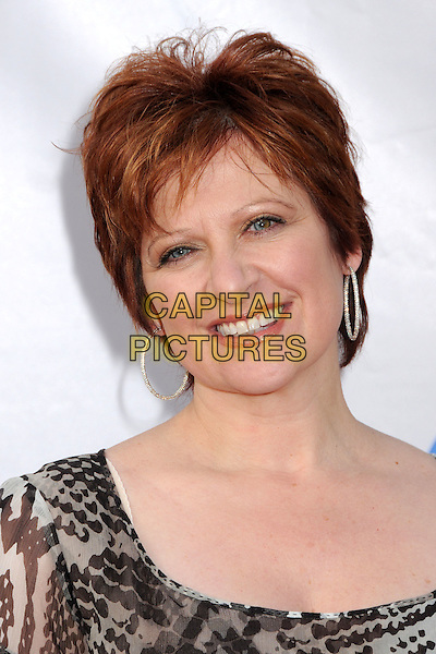"CAROLINE MANZO.The Cable Show 2010 ""An Evening with NBC Universal"" held at Universal Studios Hollywood, Universal City, California, USA..May 12th, 2010.headshot portrait grey gray black print hoop earrings silver .CAP/ADM/BP.©Byron Purvis/AdMedia/Capital Pictures."