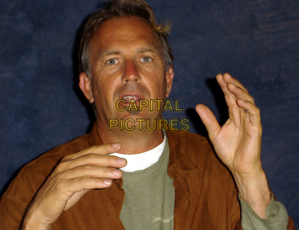 """KEVIN COSTNER.Press conference for """"Mr. Brooks"""", Le Meridian, Beverly Hills, California, USA..May 21st, 2007.headshot portrait soul patch facial hair hands mouth open .CAP/AW.©Anita Weber/Capital Pictures"""