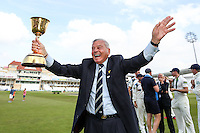 Picture by Alex Whitehead/SWpix.com - 12/09/2014 - Cricket - LV County Championship Div One - Nottinghamshire CCC v Yorkshire CCC, Day 4 - Trent Bridge, Nottingham, England - Yorkshire's club president Dickie Bird celebrates with the trophy.