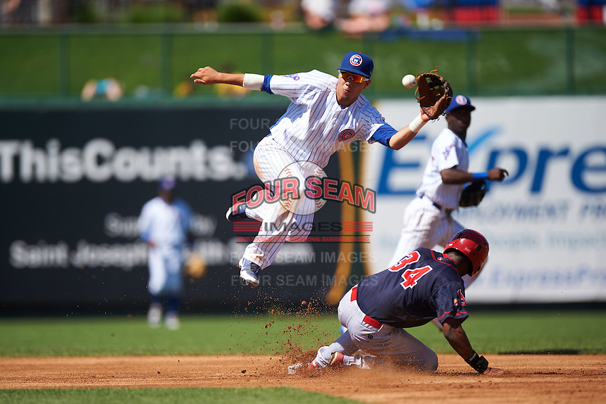 South Bend Cubs second baseman Carlos Sepulveda (2) jumps for a throw as Magneuris Sierra (34) slides in during the second game of a doubleheader against the Peoria Chiefs on July 25, 2016 at Four Winds Field in South Bend, Indiana.  South Bend defeated Peoria 9-2.  (Mike Janes/Four Seam Images)