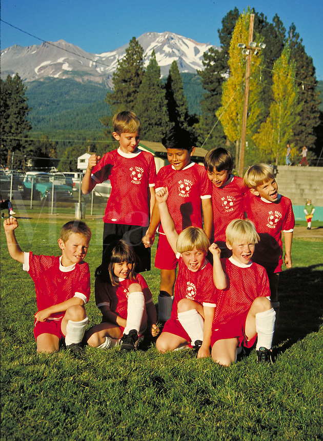 youth mixed gender soccer team in uniform posing for portrait. team members. California USA.