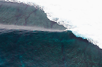 Aerial view of an empty wave breaking at Tavarua, Fiji