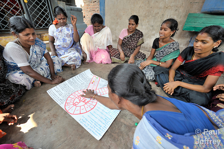 A neighborhood women's group in Chennai, India, learns about HIV and AIDS as they play a game designed by educators from the Madras Christian Council of Social Service.
