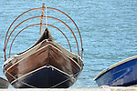 A traditional wooden boat in Ossuccio, a small town near Sala Comacina, a town on Lake Como, Italy.