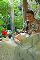Woman recieving Pohaku, hot stone therapy, at the Mauna Lani spa on the Big Island of Hawaii