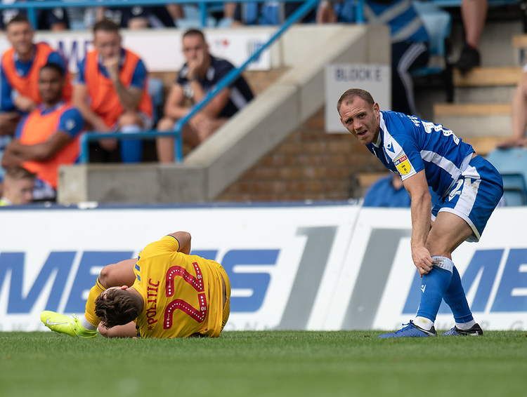 Bolton Wanderers' Dennis Politic (left) injured after a tackle by Gillingham's Barry Fuller (right) <br /> <br /> Photographer David Horton/CameraSport<br /> <br /> The EFL Sky Bet League One - Gillingham v Bolton Wanderers - Saturday 31st August 2019 - Priestfield Stadium - Gillingham<br /> <br /> World Copyright © 2019 CameraSport. All rights reserved. 43 Linden Ave. Countesthorpe. Leicester. England. LE8 5PG - Tel: +44 (0) 116 277 4147 - admin@camerasport.com - www.camerasport.com