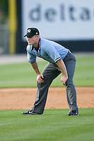 Umpire Sean Barber handles the calls at second and third base during a Southern League game between the Jacksonville Suns and the Carolina Mudcats at Five County Stadium May 15, 2010, in Zebulon, North Carolina.  Photo by Brian Westerholt /  Seam Images