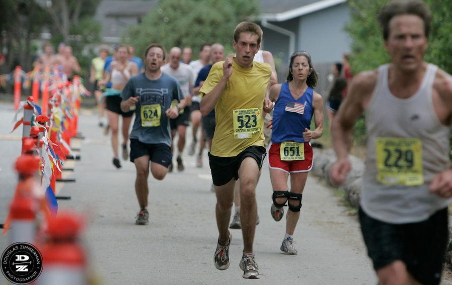 Brent Hammond (523) of Mill Valley races to the finish line at the 99th running of the Dipsea Race at Sintson Beach State Park in Stinson Beach, Calif. on Sunday June 14th, 2009. ..