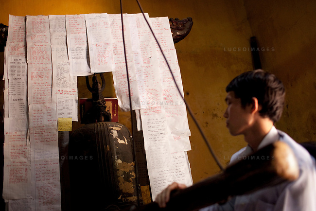 Nguyen Van Nam, 25, a Buddhist volunteer at the pagoda, rings a bell during prayer time at the Giac Vien Pagoda in District 11 in Ho Chi Minh City, Vietnam. Photo taken Monday, May 3, 2010..Kevin German / LUCEO
