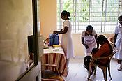 Government health workers prepare to vaccinate infants at the government health centre in Tharmapuram in North Kilinochchi, Sri Lanka.  Photo: Sanjit Das/Panos
