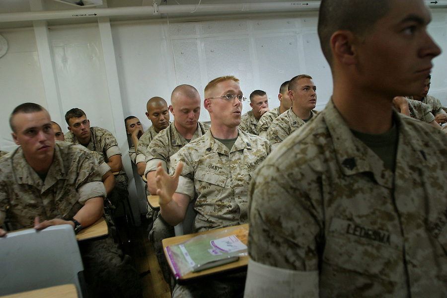 In a classroom aboard the USS Belleau-Wood, Sgt. Landon Gant (Weapons Platoon, Charlie Co. 1/4 Marines) raises a question during a briefing on Middle East politics and religion by an expert from the Naval Postgraduate School in Monterey, CA. The briefings are designed to give the enlisted Marines an understanding of the fundamentals of Iraqi society, history, and politics.