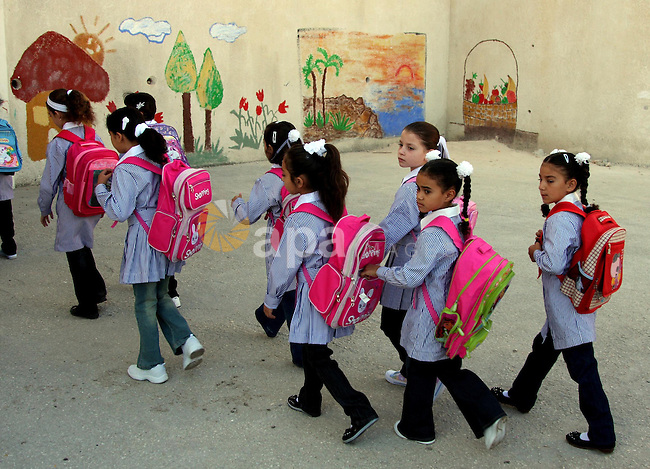 Palestinian students return to their school in the first day of new school year in the West Bank city of Ramallah on Sep 01, 2009.  Photo by Issam Rimawi