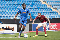 Frank Nouble of Colchester United under pressure from Nicky Adams of Northampton Town during Colchester United vs Northampton Town, Sky Bet EFL League 2 Football at the JobServe Community Stadium on 24th August 2019